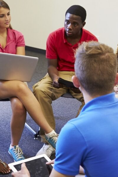 C:\Users\user\Downloads\Multi-racial-group-of-high-school-students-sitting-in-a-circle-talking-and-holding-laptops-and-tablets.jpg
